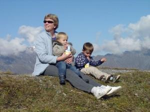 grandma-noah-toby-sitting-on-a-mountain-ridge-drinking-ice-tea